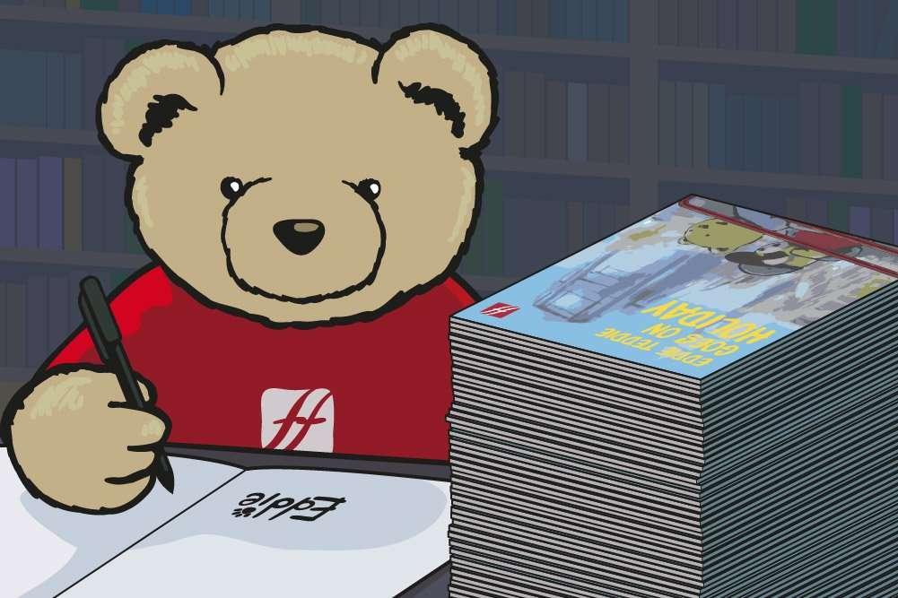 Eddie Teddie signing his second book; Eddie Teddie Goes on Holiday